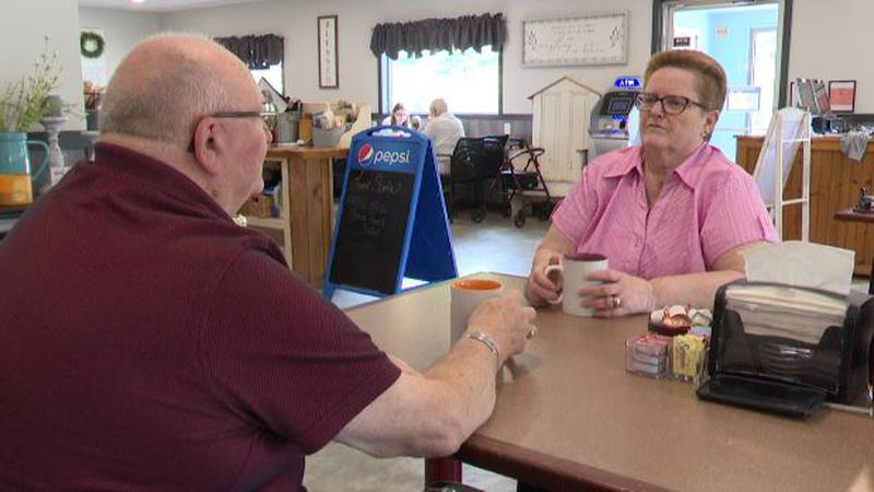 Sipping from their coffee cups at Meme's Diner in Felts Mills, Bonnie and Jim Topping talk New...