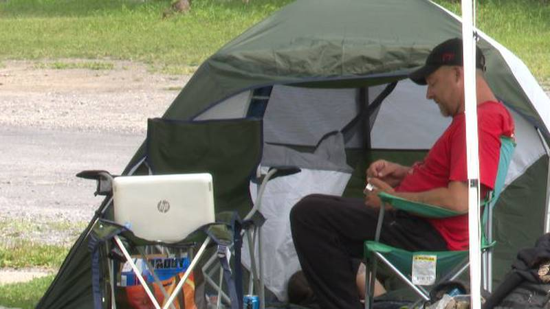 Tenants set up camp near their condemned apartment building