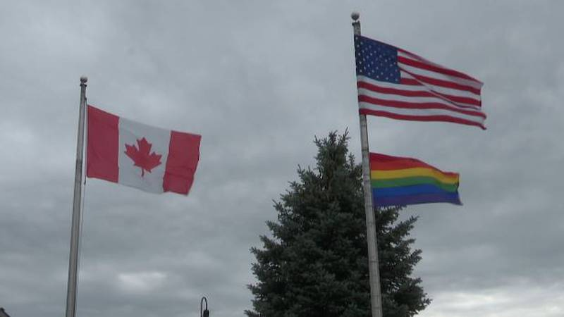 American, Canadian and Pride flags fly in Clayton in June