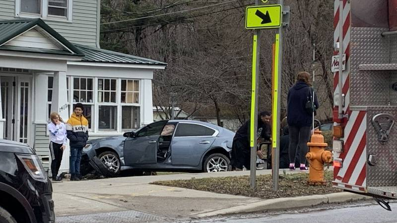 Two vehicles crashed into homes on State Street in Watertown early Friday afternoon.