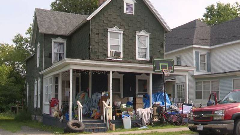 Tenants' belongings sit on the porch of 639 Emerson Street, which was condemned
