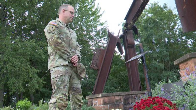 Major Tobias Clark stands at the 9/11 memorial at Clarkson University.