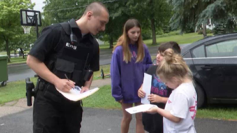 """Norwood Police Officer Joshua Eng hands out """"positive tickets"""" to youths who are doing..."""