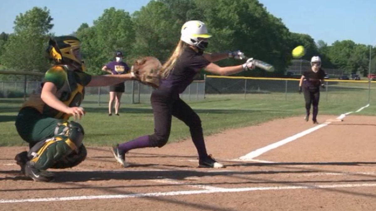 Heuvelton's Molly Williams lays down a bunt in a softball contest against Norwood-Norfolk,...