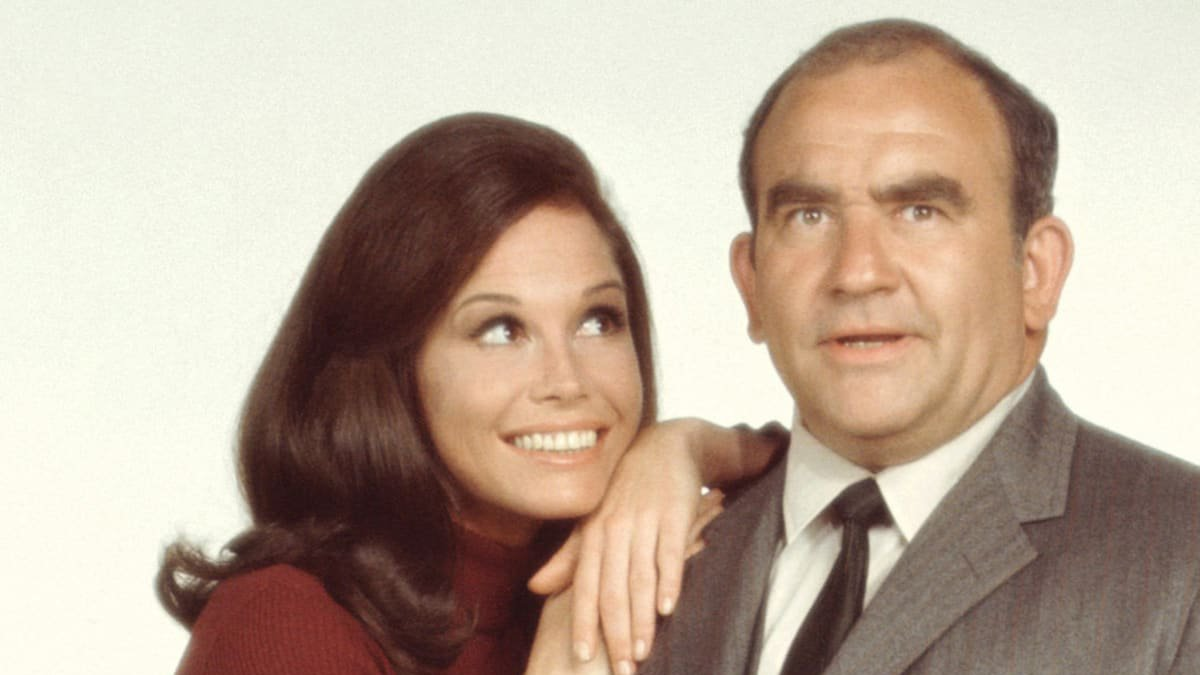 Ed Asner as Lou Grant, Mary Tyler Moore as Mary Richards