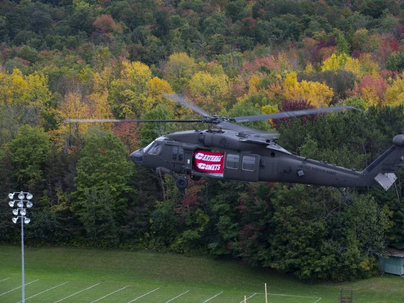 Two Black Hawk helicopters flew over the Carthage High School football field and displayed a...