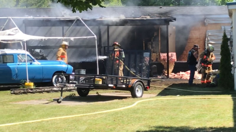 Fire officials believe a grill started a fire at a trailer home in Calcium Monday afternoon.