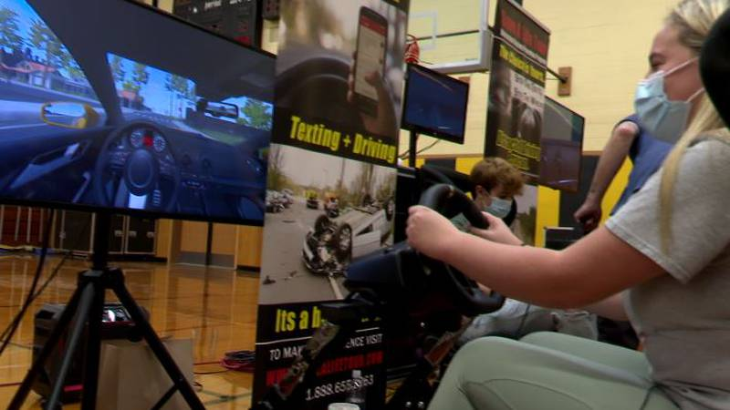 A South Jefferson Central student tries a 'distracted driving' simulator.