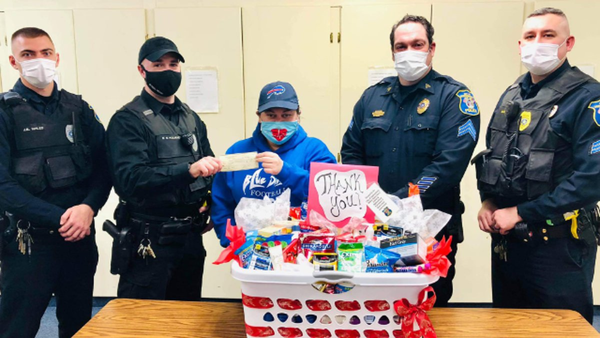 Unions representing Ogdensburg city police donate cash and items to employees of United Helpers...