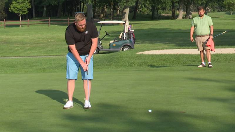 Rick Algie tries to sink a putt during quarterfinal action in the Watertown Men's City Golf...