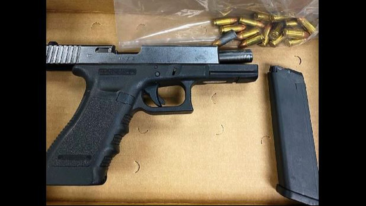 Police say they found a loaded 9mm Glock 17 pistol, contained an illegal high-capacity magazine