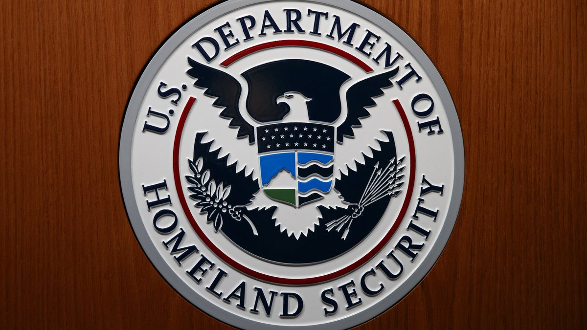 The Department of Homeland Security (DHS) seal is seen during a news conference with acting...