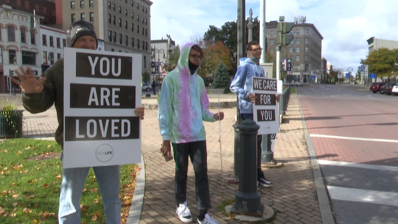 Members from Watertown's New Life Christian Church spent Sunday holding up signs and passing...