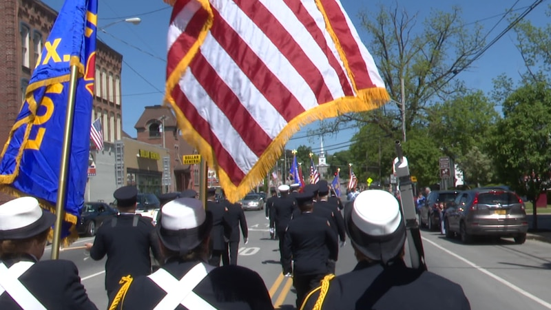 Walking to the beat of a drum, and to the direction of the VFW commander, veterans of Lewis...