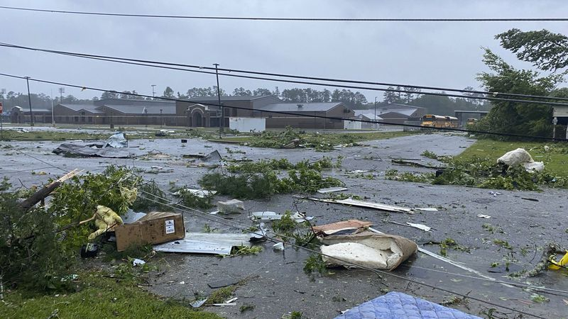 This photo provided by Alicia Jossey shows debris covering the street in East Brewton, Ala., on...