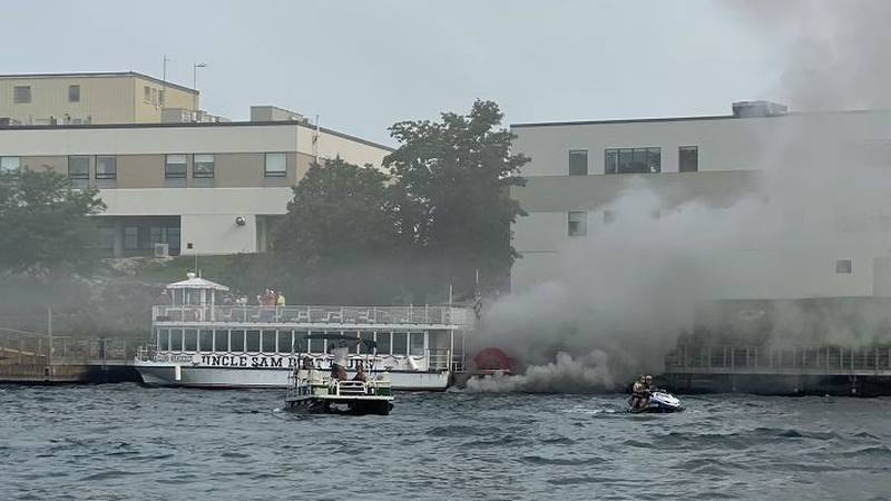 Nearly 40 people escaped injury when thick black smoke began pouring from an Uncle Sam Boat...