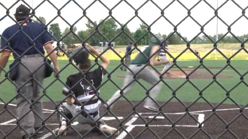 Copenhagen's Landon Sullivan heads for first base after he singles to center field, bringing in...
