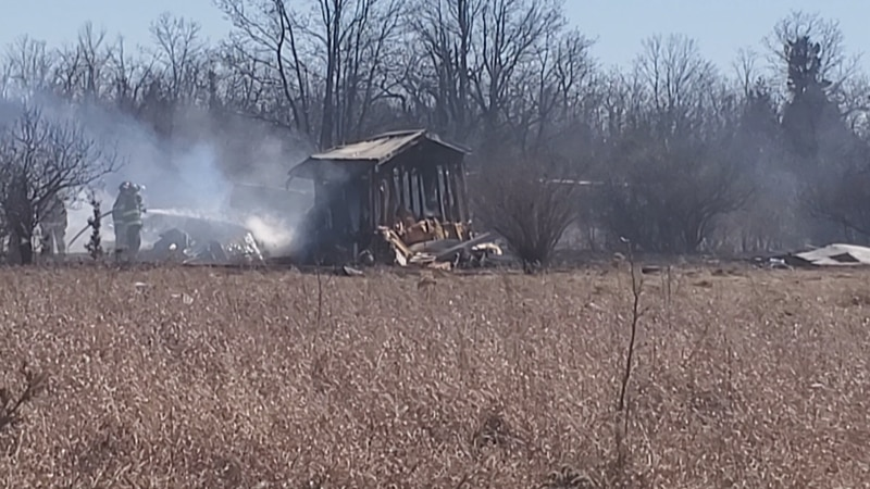 A brush fire in Clayton destroyed a trailer Sunday afternoon.