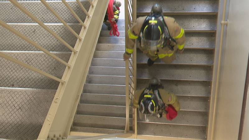 Volunteer firefighters climbed flights of stairs to honor those first responders who lost their...