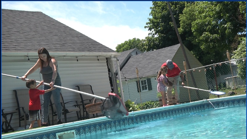 Lottery winners Brianna Valeriano and Kyron Holley, poolside with their children, at their new...