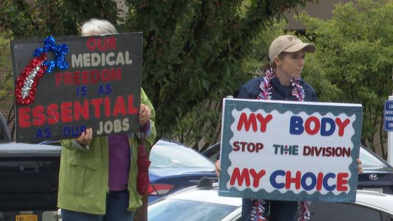 Some health care workers protested against the state-mandated vaccine outside Watertown's...