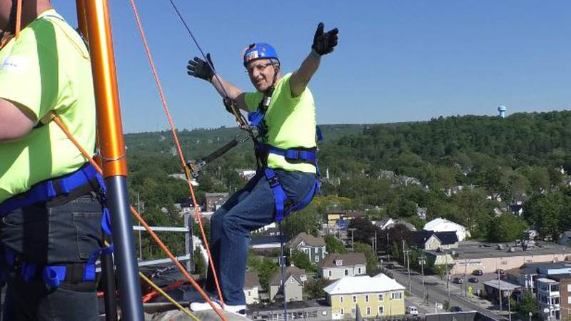 Joe Rich gets ready to rappel down Midtown Towers