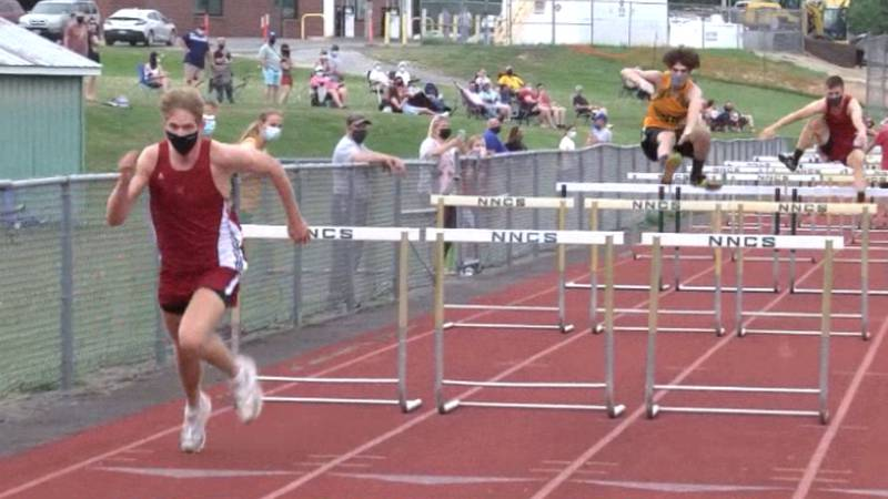 Massena's Ryan Deshane takes first in the 110 hurdles in a track and field meet against...