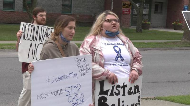 File photo of Alexis Stevens, on the right, protesting outside the St. Lawrence County...