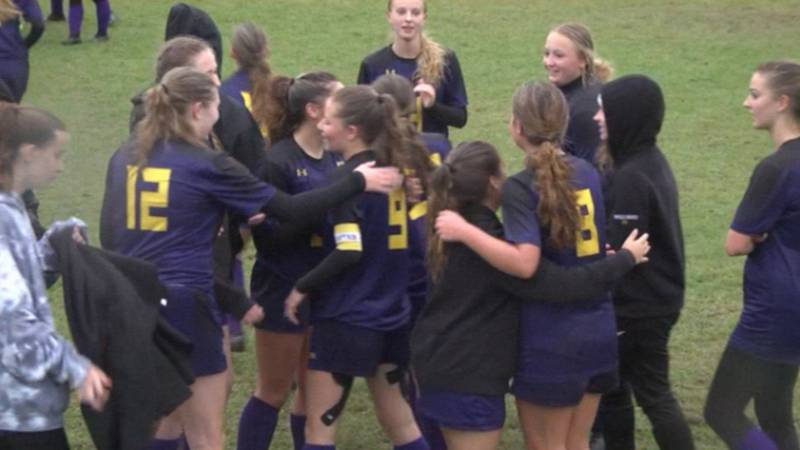 Members of the Colton-Pierrepont girls' soccer team celebrate their SectionX quarterfinal win...
