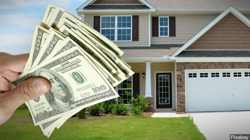 Graphic of home with money.
