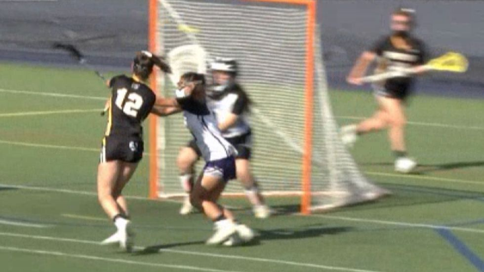 Julia Garvin scores for the Lady Spartans in a girls' Frontier League lacrosse contest that...