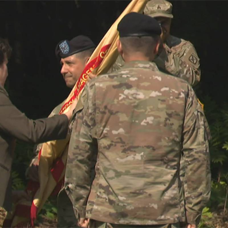 Col. James Zacchino Jr. accepts the unit colors as he takes command of the Fort Drum garrison...