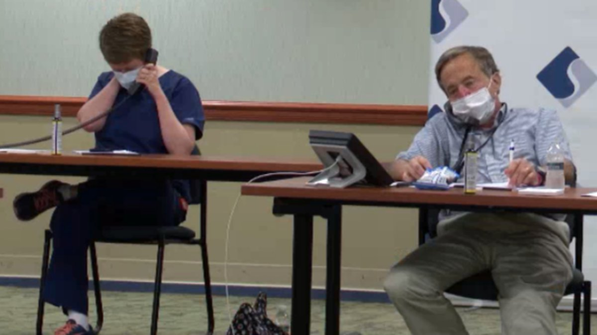 Doctors and public health officials staffed a phone bank at Samaritan Medical Center August 18,...
