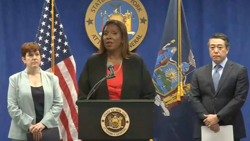 New York Attorney General Letitia James, flanked by independent investigators Anne Clark and...